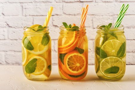 Detox fruit infused water. Refreshing summer homemade cocktail, selective focus. Archivio Fotografico