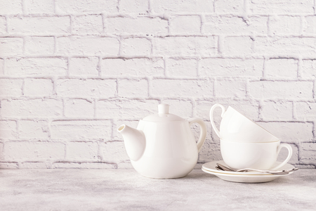 Two cups and teapot for morning tea. Copy space.