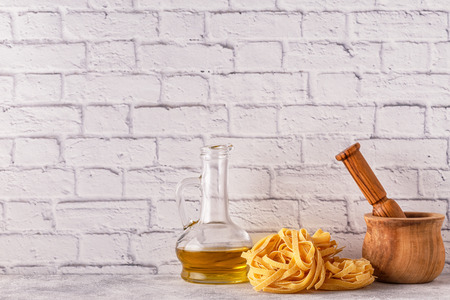 Products for cooking - pasta, tomatoes, garlic, olive oil, basil. Selective focus. Stock Photo - 91375993