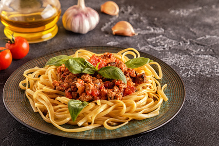 Italian pasta bolognese.  Selective focus. Фото со стока