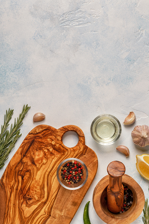 Cutting board and spice for cooking on a light background. Reklamní fotografie