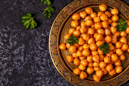 Cooked chickpeas on a plate, top view, copy space. Archivio Fotografico