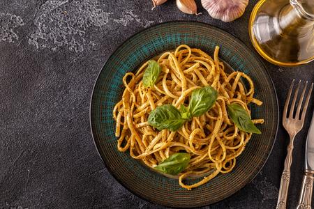 Pasta with homemade pesto sauce. Top view.