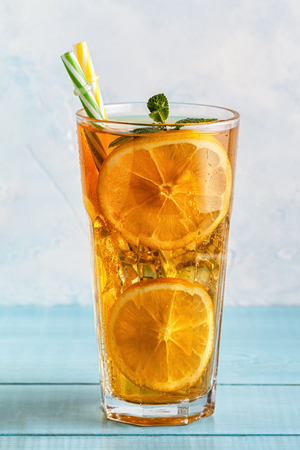 Iced tea with lemon slices and mint. Selective focus.