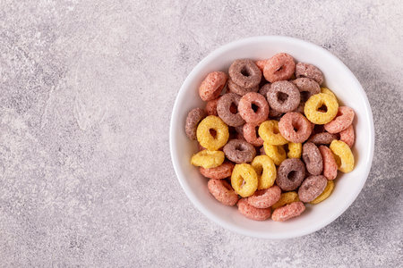 Colorful cereal rings in bowl. Top view.