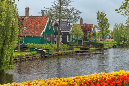 Traditional Houses in the Historic Village of Zaanse Schans on the Zaan River in the Netherlands Stock Photo