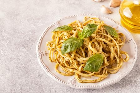 Pasta with homemade pesto sauce. Selective focus.