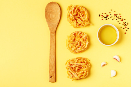 Flat lay pastel tone background. Ingredients for cooking on a yellow bright background.