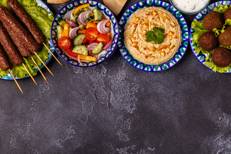 Classic kebabs, falafel and hummus on the plates. Top view, copy space. Stockfoto