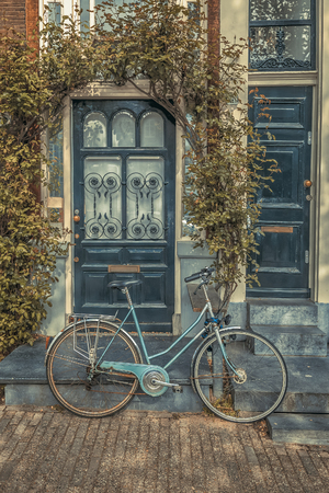 Old Bicycle in front of a House.