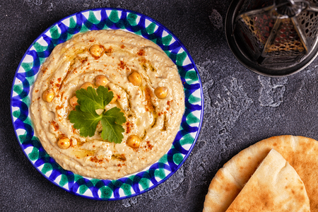 Classic hummus  on the plate. Top view, copy space.