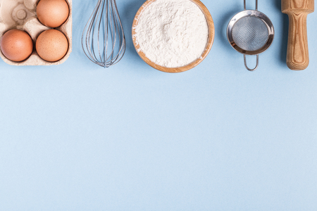 Ingredients for baking  on a blue background. Top view, copy space.