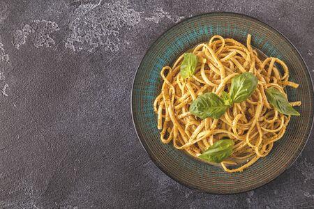 Pasta with homemade pesto sauce. Top view. Archivio Fotografico - 95777580