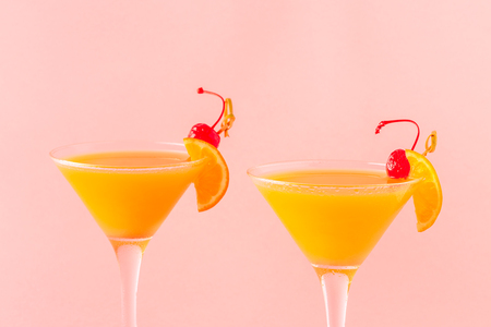 Yellow cocktail on a bright background, selective focus.