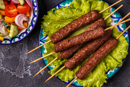 Classic kebabs on the plate. Top view. Stock Photo