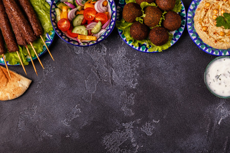 Classic kebabs, falafel and hummus on the plates. Top view, copy space. Banco de Imagens