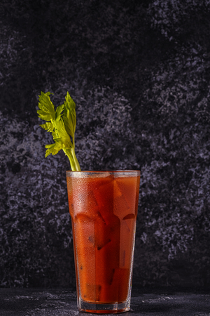 Classic cocktail - Bloody Mary on a dark background.