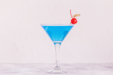 Blue Curacao cocktail decorated with fruit, selective focus.