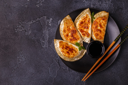 Plate of asian gyoza, dumplings snack with soy sauce. Stock Photo - 98292313