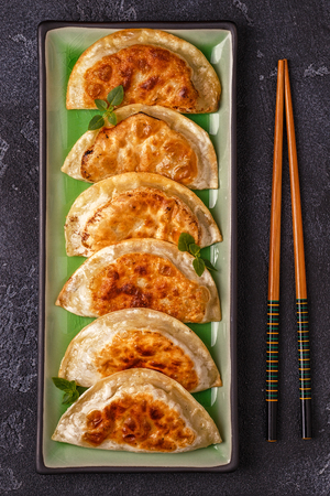Plate of asian gyoza, dumplings snack with soy sauce. Stock Photo - 98292318
