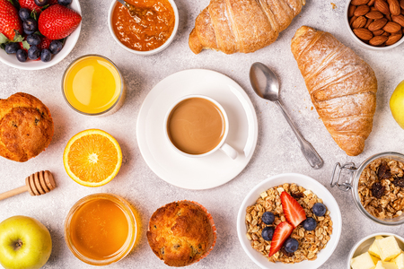 Continental breakfast with fresh croissants, orange juice and coffee, top view. Stock Photo