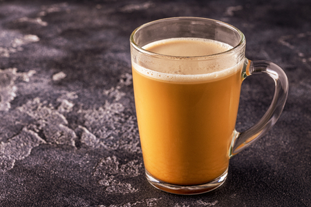 Bulletproof coffee, blended with organic  butter and MCT coconut oil, paleo, keto, ketogenic drink breakfast.