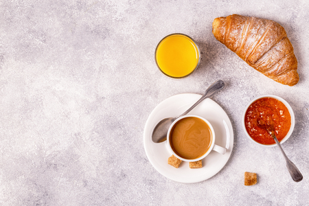 Continental breakfast with fresh croissants, orange juice and coffee, top view. 스톡 콘텐츠