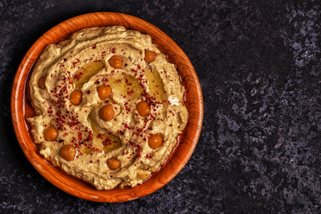 Classic hummus with parsley on the plate and pita bread.