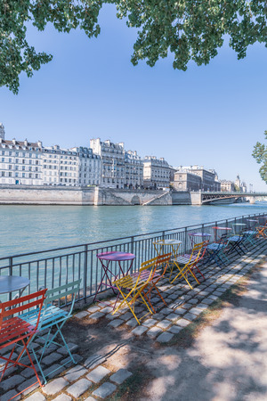 Empty outdoor cafe on the banks of the Seine, Paris, France.