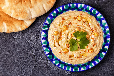 Classic hummus  on the plate. Top view, copy space. Archivio Fotografico - 102363622