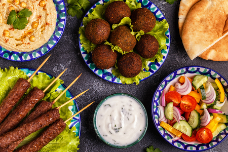 Classic kebabs, falafel and hummus on the plates. Top view. Archivio Fotografico - 102363678
