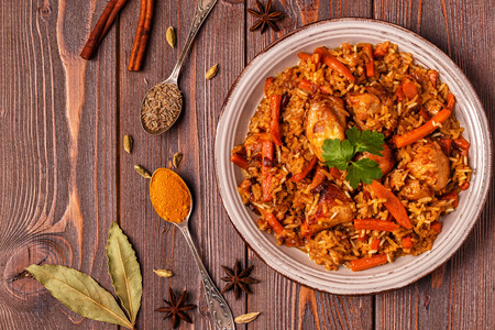 Pilaf (biryani) on a wooden background, top view, copy space. Stockfoto - 103440277