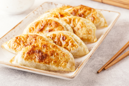 Plate of asian gyoza, dumplings snack with soy sauce. 스톡 콘텐츠