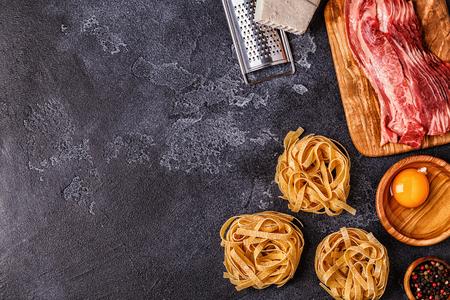 Ingredients for Pasta Carbonara on dark background, top view. Archivio Fotografico - 106564236