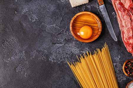 Ingredients for Pasta Carbonara on dark background, top view. Archivio Fotografico - 106564247
