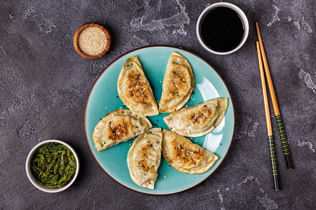 Gyoza or dumplings snack with soy sauce, top view. Stock Photo - 106735895