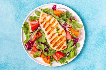Chicken breast with fresh salad, top view. Banco de Imagens