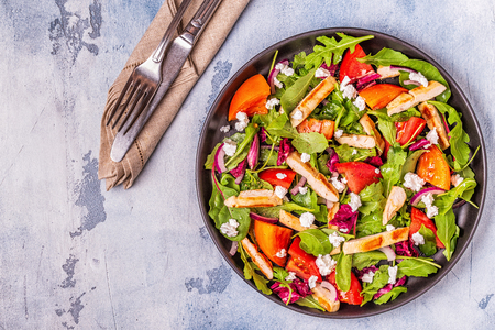Fresh salad with chicken breast, top view.