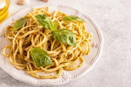 Pasta with homemade pesto sauce. Selective focus. Archivio Fotografico - 106833581