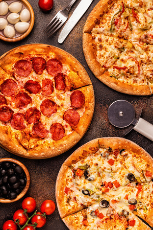 Set of different pizzas - pepperoni, vegetarian, chicken with vegetables, top view Stok Fotoğraf