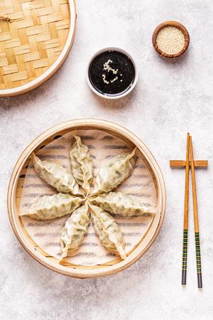 Asian dumplings, soy sauce, chopsticks. Top view, copy space.