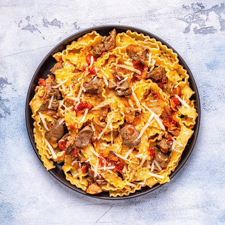 Pasta with chicken liver sauce, top view. Zdjęcie Seryjne