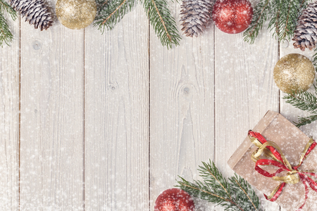 Christmas gift boxes and fir tree  on wooden background. Top view with copy space Stok Fotoğraf