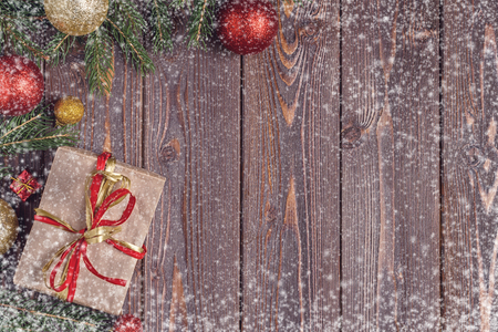 Christmas gift boxes and fir tree  on wooden background. Top view with copy space 版權商用圖片