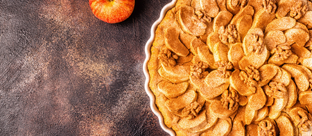Apple pie with walnuts and cinnamon, top view.