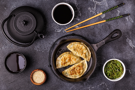 Gyoza or dumplings snack with soy sauce, top view. Stock Photo - 109293977