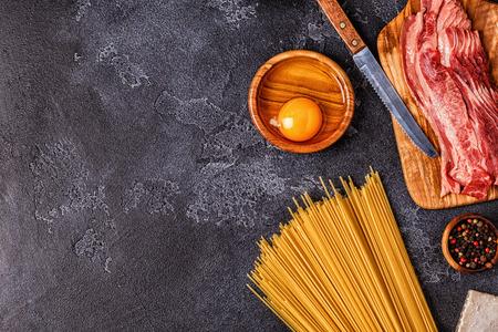 Ingredients for Pasta Carbonara on dark background, top view. Archivio Fotografico - 109294041