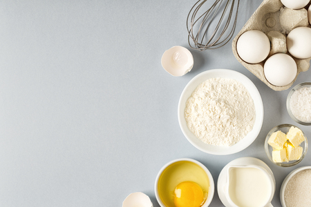 Background with ingredients for cooking, baking, flat lay, top view. Reklamní fotografie