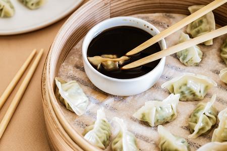 Asian gyoza, dumplings snack, chopsticks, steamer, selective focus. Stock Photo - 109294061