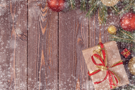 Christmas gift boxes and fir tree  on wooden background. Top view with copy space Banco de Imagens